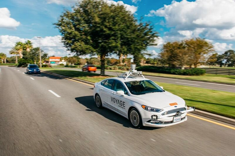 Figure 1.  A Voyage self-driving taxi on the road at The Villages community in Florida.