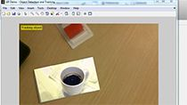 Use object recognition and tracking to create an augmented reality application with a webcam in MATLAB . Recognize an image in a scene, track its position, and augment the display by playing a video in the image's place.